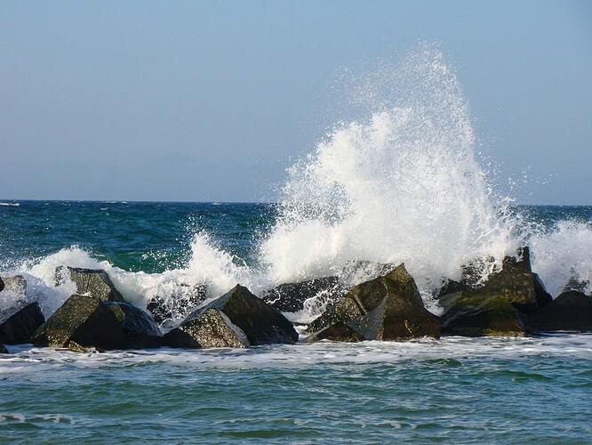 waves_crush_rocks_ref_shallow.jpg
